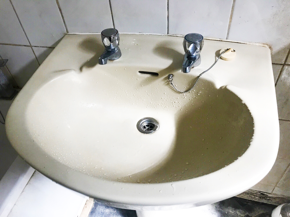 Picture of Sink With One Faulty Tap